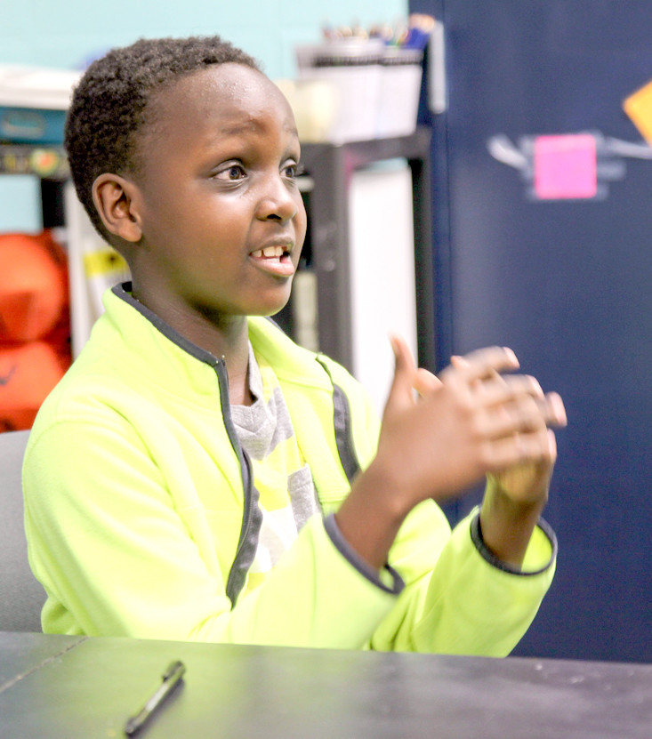 FOURTH-GRADE STUDENT Baraka Ndegwa speaks about the encouragement that the Happiness Sprinkling program offers the community.