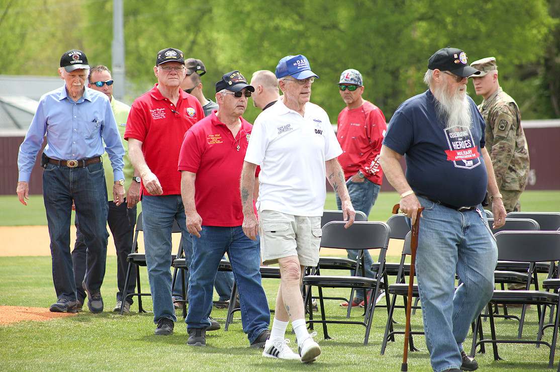 VETERANS of the Armed Services take the field for the ceremony honoring them on Military Appreciation Day at Lee University's baseball field.