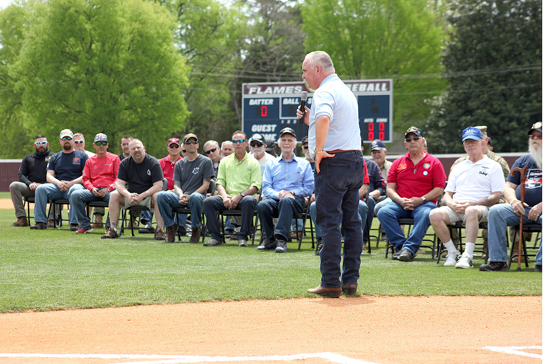 STATE REP. Kevin Brooks, shows his appreciation for the veterans on the field at Saturday's appreciation ceremony.