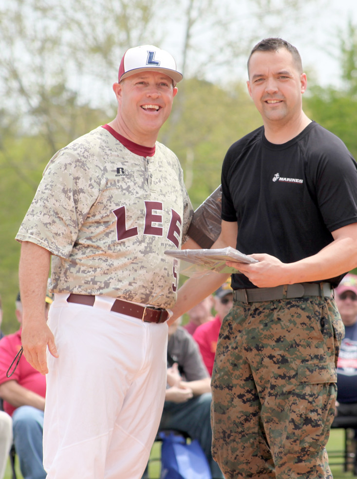 SGT. RYAN MAY, right, from the United State Marine Corps accepts a plaque from Mark Brew for the Marines' support of the Military Appreciation Day event.