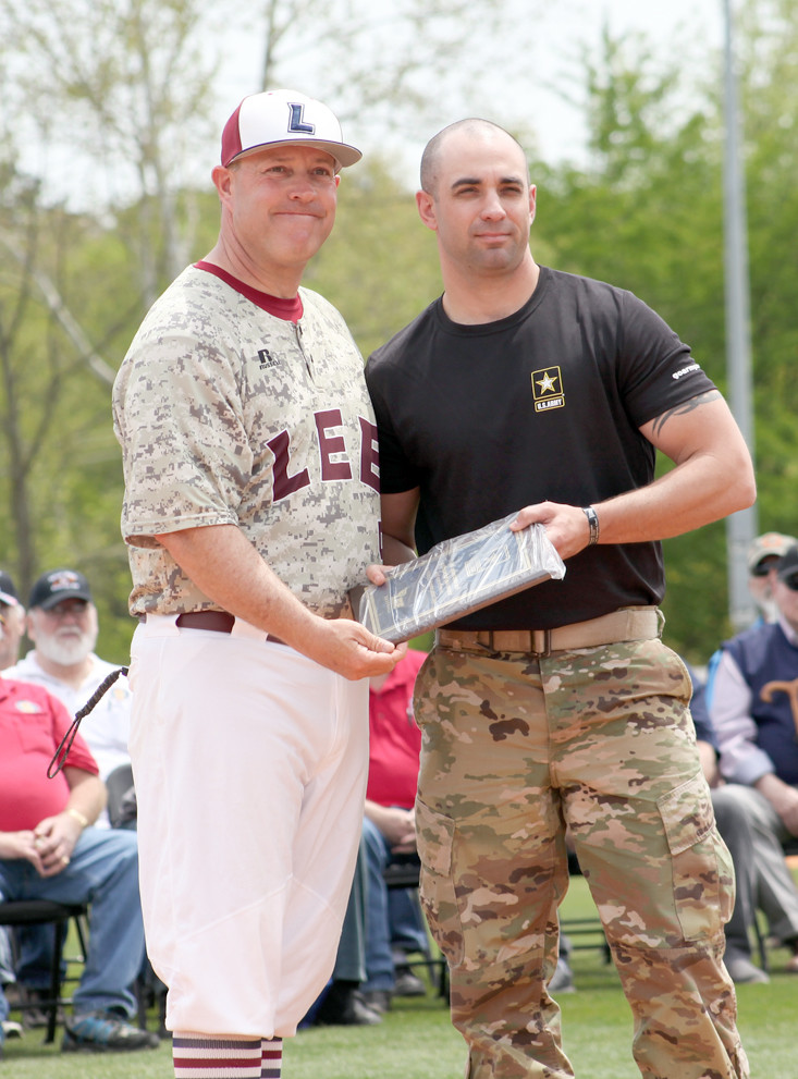 U.S. ARMY SGT. CRICKEN Armstrong, right, accepts a plaque from Mark Brew for the Army's support of the Military Appreciation Day event.