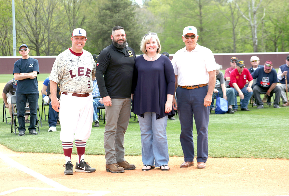 MASTER GUNNERY SERGEANT, Sam Dean, 2nd from the left, accepts the first Bobby Taylor Memorial Scholarship at the Military Appreciation Day event on Saturday. F left are Lee University Baseball Coach Mark Brew, Dean, Christy Goza and Scott Taylor.