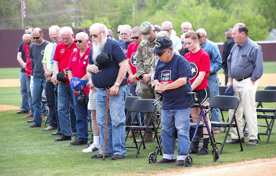 THE VETERANS bow their heads in honor of those from the armed services who have lost their lives or have gone missing in the line of duty.