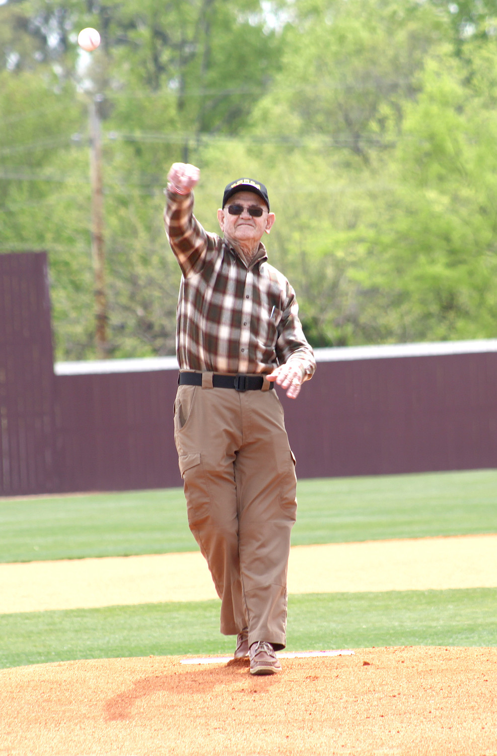 "BILL ""SARGE"" FITE (USMC) throws out one of the honorary first pitches at the Military Appreciation Day event."