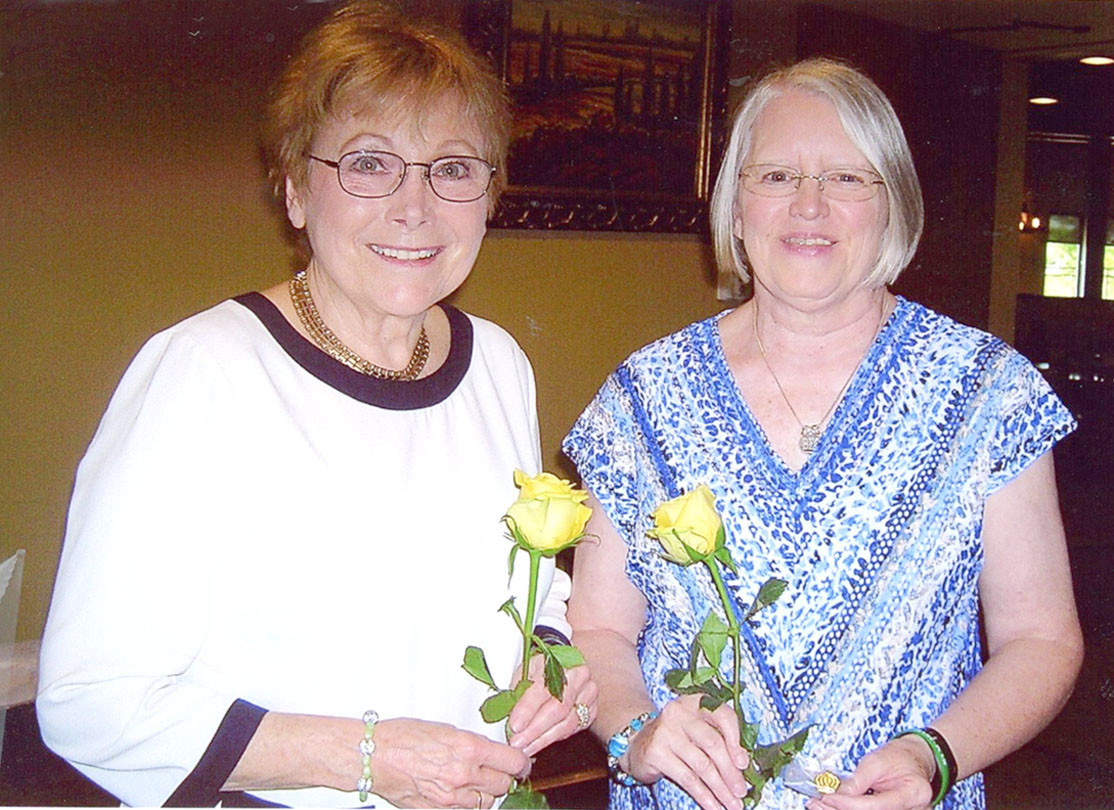 The Laureate Alpha Xi chapter of Beta Sigma Phi crowned Joan Day, left, Woman of the Year, and Karen Griffith, right, Valentine Queen for 2018.