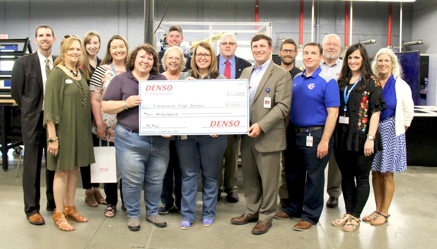 REPRESENTATIVES of Cleveland City Schools, DENSO and the Cleveland/Bradley Chamber of Commerce gathered at Cleveland High School Friday to celebrate a grant presentation. DENSO has awarded CHS a $10,000 grant for the third year in a row.