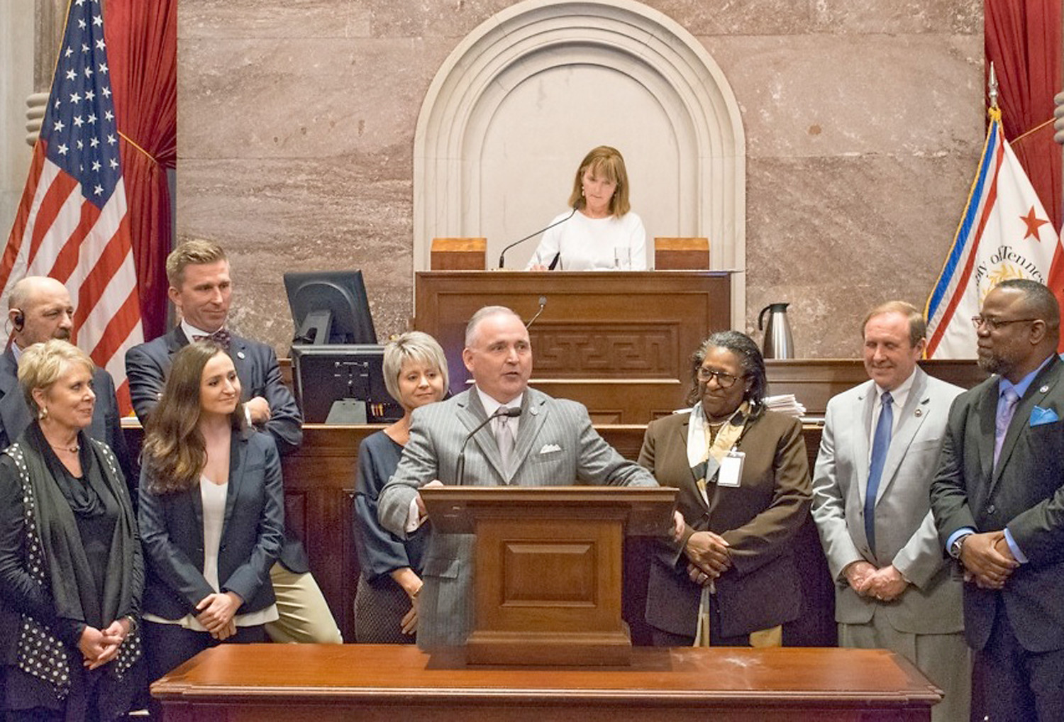 STATE REP. KEVIN BROOKS speaks during a session of the Tennessee House of Representatives, where he is being honored upon his retirement from state government. Brooks was joined by family members for the observance. In the background is House Speaker Beth Harwell (R-Nashville).