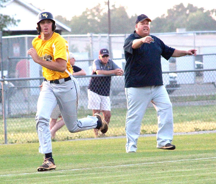 CALEB LAWHON races home as Walker Valley head coach Joe Shamblin directs from the third base coaching box. Lawhon had three hits in his final game as a Mustang.