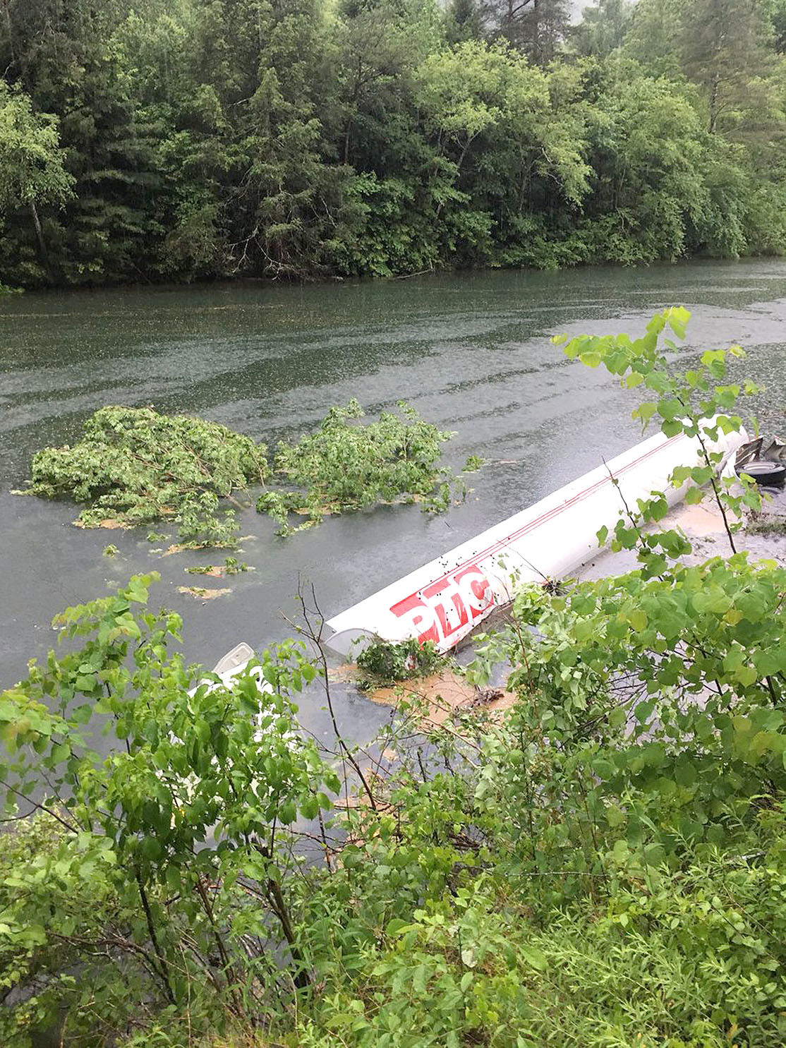 EMERGENCY RESPONDERS were busy overnight attempting to remove a tanker truck from the Ocoee River, along Highway 64. Highway traffic was still being detoured this morning, awaiting removal of the truck from the river and cleanup of several hundred gallons of fuel. Photograph courtesy of Hamilton County HazMat team.