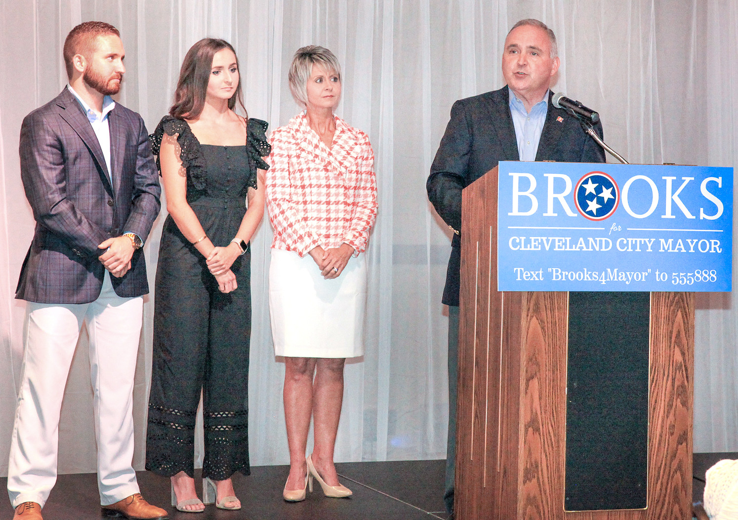 REP. KEVIN BROOKS, right, addresses the crowd at his official Campaign Kickoff on Friday evening at the Museum Center in downtown Cleveland. From left are Brooks' family: son, Zach; daughter, Elizabeth and wife, Kim.