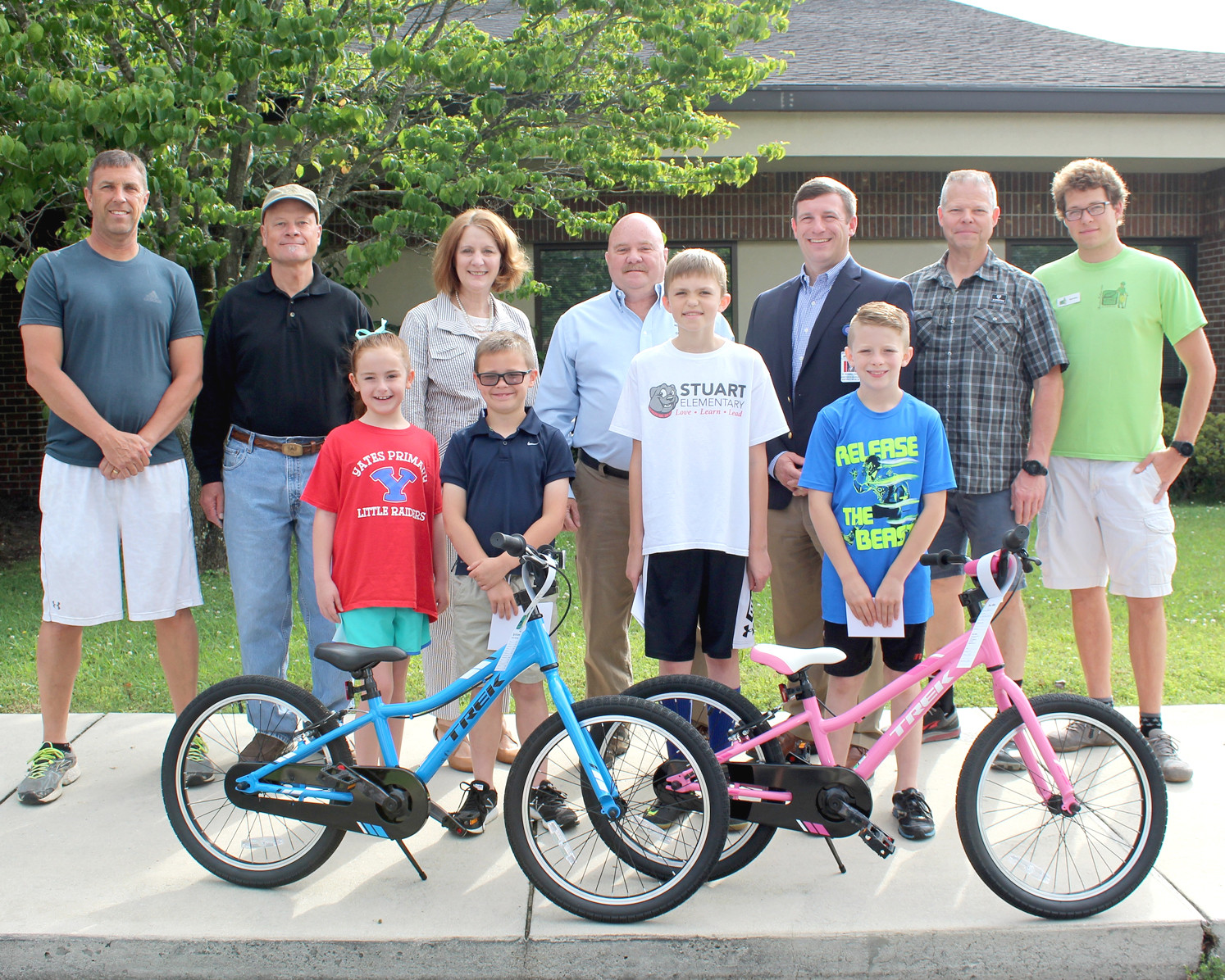 FOUR STUDENTS recently received vouchers for new bicycles as a reward for perfect school attendance. In the front, from left, are Alyson Reiter of Yates Primary School, Neyland Croft of Valley View Elementary School, Elijah Eledge of George R. Stuart Elementary School and Joseph Douglas of Taylor Elementary School. Joining them are Franklin Elrod, teacher at Taylor Elementary; Bruce Bancroft, master of the Cleveland Masonic Lodge; Bradley County Schools Director Dr. Linda Cash, Barry Phillips, past master of the Cleveland Masonic Lodge; Cleveland City Schools Director Dr. Russell Dyer; and Doug Coulter and Brandan Coulter, both of Scott's Bicycle Centre.