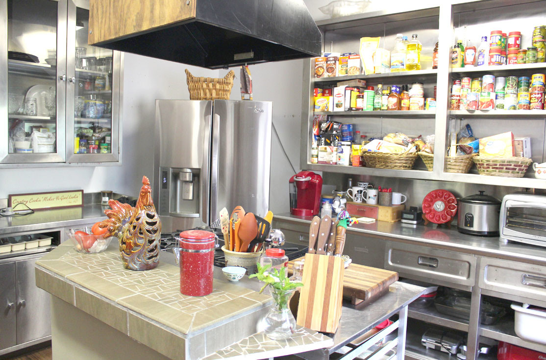 THIS COZY KITCHEN is situated at the center of The Long House, Foundation House Ministries new house for homeless mothers. Residents can use it to prepare meals for themselves and their housemates.