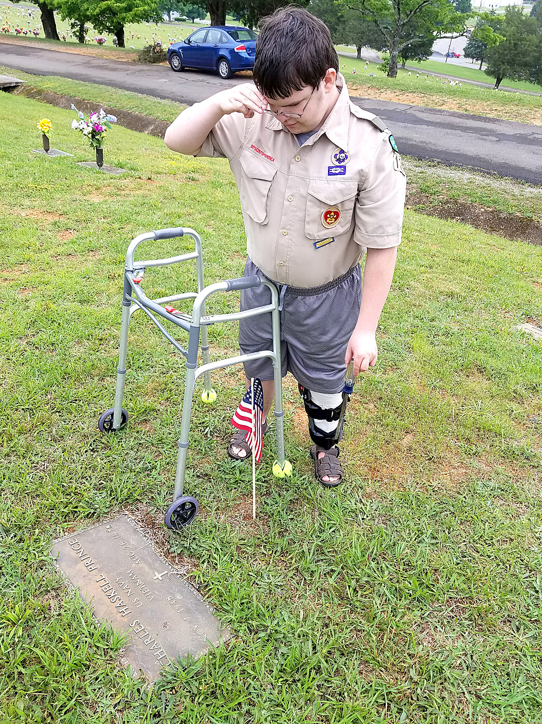 COLTON GUTHRIE was not going to let leg surgery stop him from placing flags on veterans' graves.