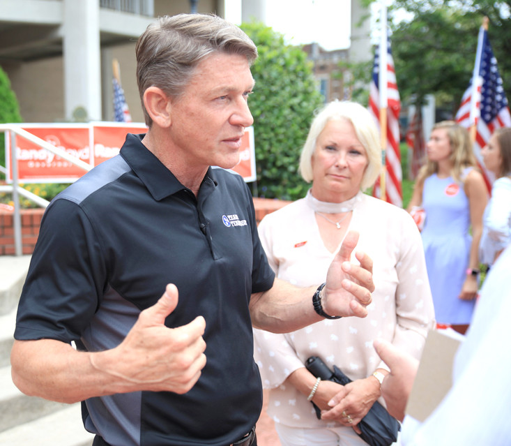 REPUBLICAN GUBERNATORIAL CANDIDATE Randy Boyd speaks to reporters after his public address on Thursday in front of the Bradley County Courthouse. Boyd's wife, Jenny, right, listens to an exchange.