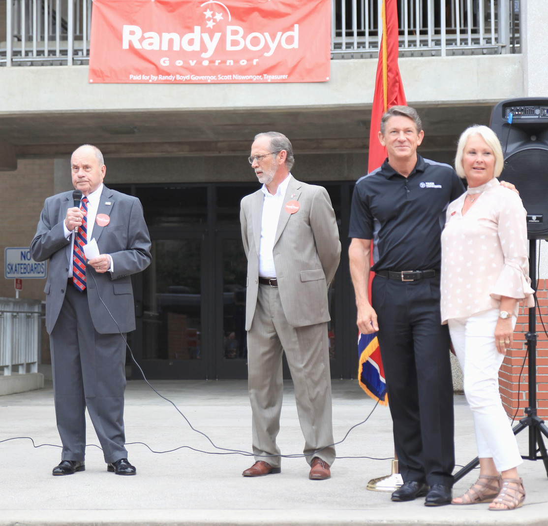 CLEVELAND MAYOR TOM ROWLAND welcomes the crowd assembled in front of the Bradley County Courthouse to meet with candidate Randy Boyd. From left are Rowland, Bradley County Mayor D. Gary Davis, Boyd and his wife, Jenny.