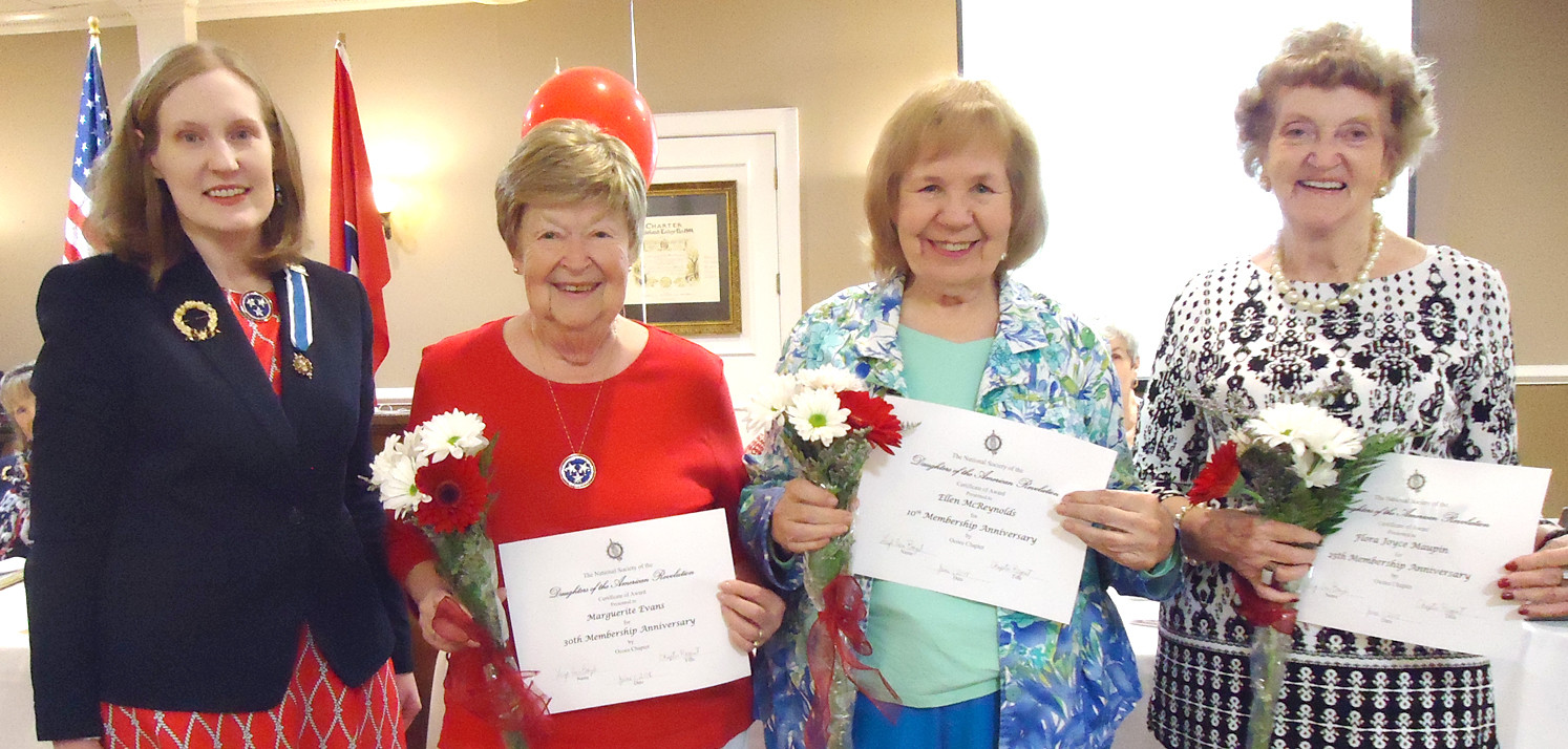 From left, Regent Leigh Ann Boyd presents membership anniversary certificates to Maggie Evans, Ellen McReynolds and Joyce Maupin.