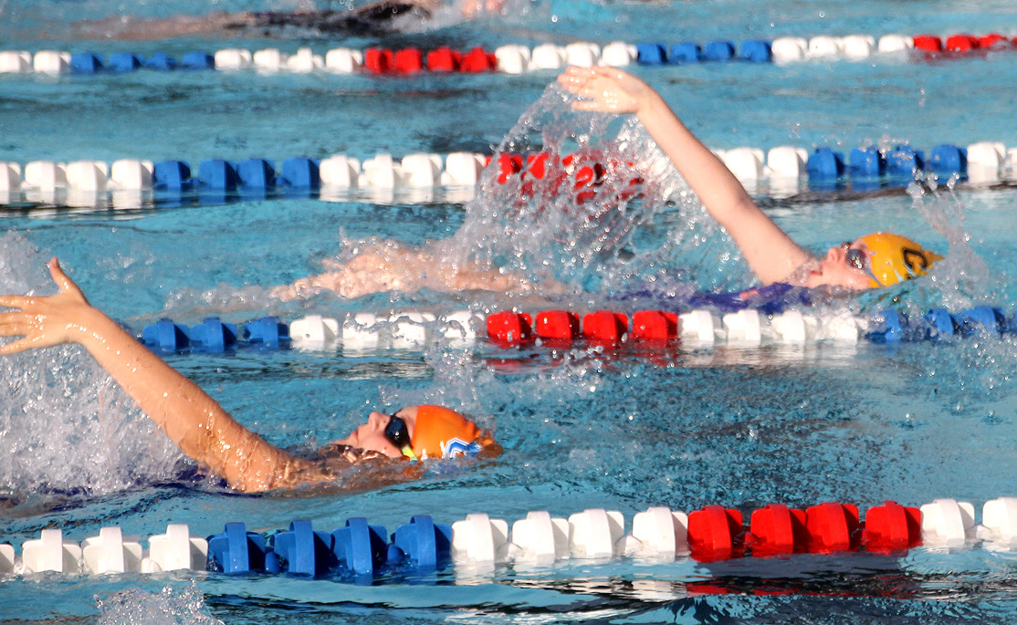 A PAIR OF Cleveland Aqua Tigers compete in the backstroke portion of the Individual Medley race during Thursday evening's CASL meet against the Chattanooga Golf & Country Club squad at the Tinsley Park pool.