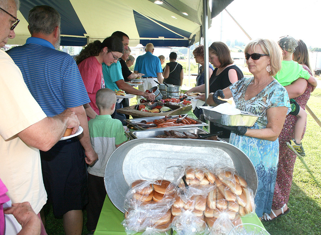 A LARGE BUFFET was available for all attendants of the Habitat of Cleveland Three-Home Dedication Thursday evening. The buffet, provided by Tasteful Gatherings, featured hot dogs, hamburgers, desserts and drinks, and was a welcome sight for hungry attendees.