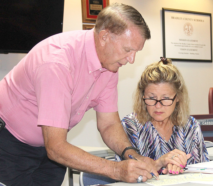 BRADLEY COUNTY Commissioner Terry Caywood speaks with Bradley County Road Superintendent Sandra Knight during Monday's Road Committee meeting.