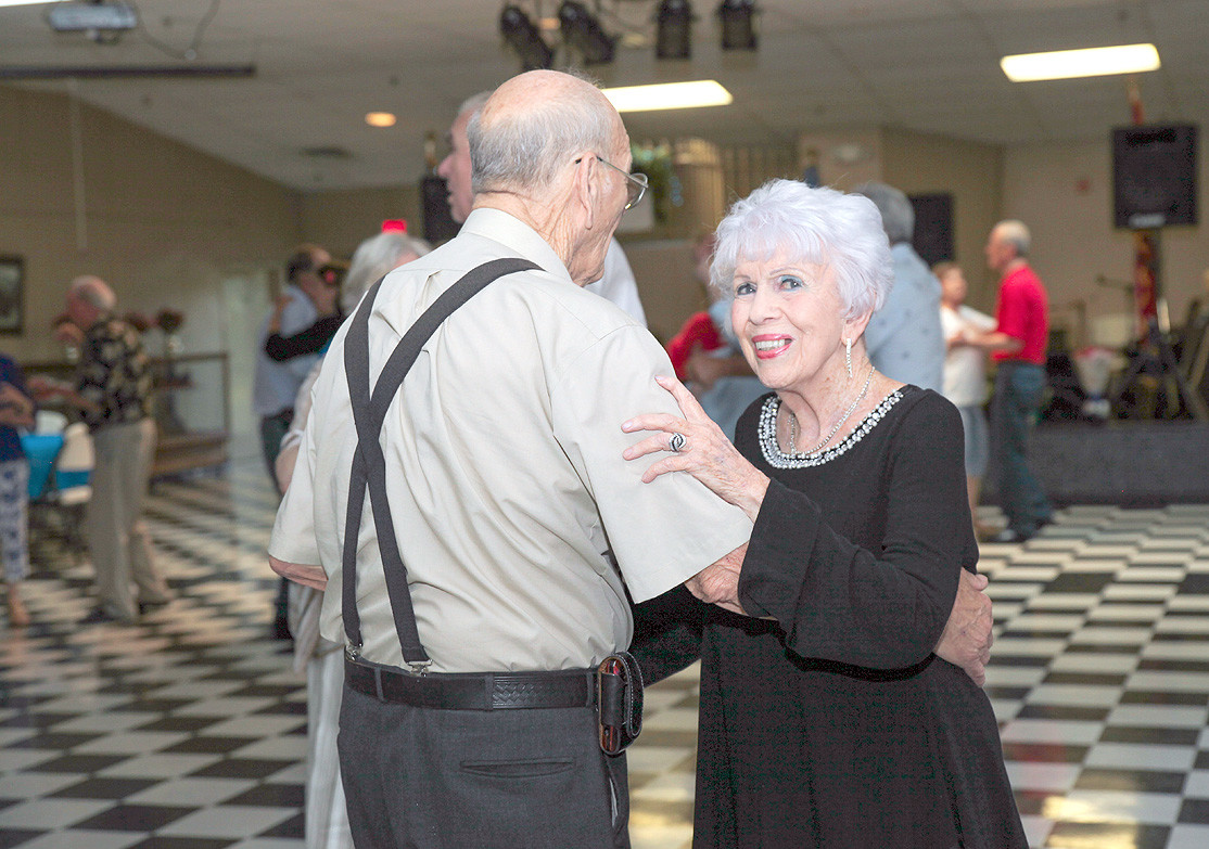 "NANCY GUINN, left, and Bill McMahan dance to ""All I Have To Do Is Dream"" by The Everly Brothers at Thursday night's event."