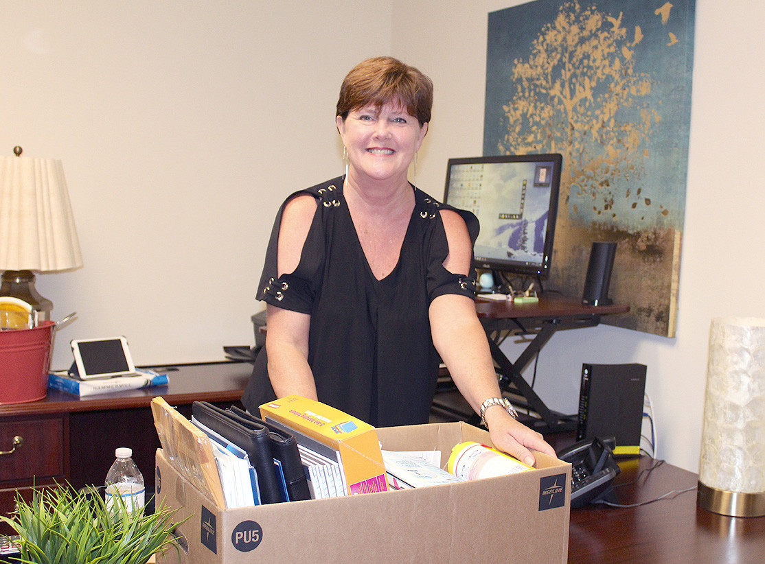 LISA GEREN, executive director of the Better Business Bureau's Cleveland branch, is in the process of packing up the office to move to a new location.