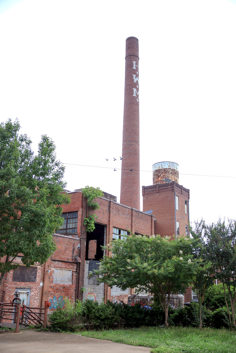 THE OLD SMOKESTACK towers high over the Old Woolen Mill in South Cleveland. Several retail shops are located in the historic structure, and improvements and expansion continues. Some office space is being renovated within the old building, and it is destined for a new roof in May's building permits.