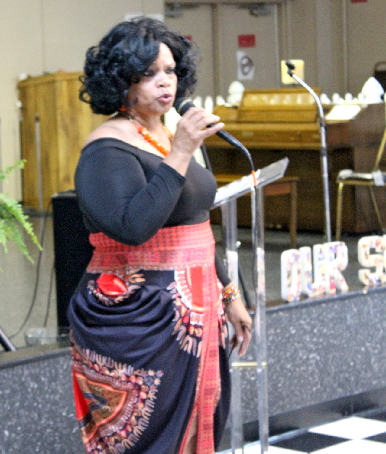 "LAVINIA JOHNSON sings ""It Ain't Over Until God Says It's Over"" to onlookers attending the second annual Juneteenth Family & Friends Festival held Saturday at the Senior Center on Urbane Road."