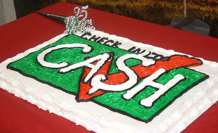Colorful cake commemorating the 25th anniversary of Check Into Cash.