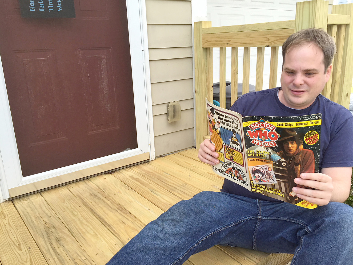 "ASHLEY RABURN ENJOYS SOME down time reading an old ""Dr. Who"" magazine with his hero, the Fourth Doctor (Tom Baker) on the cover."