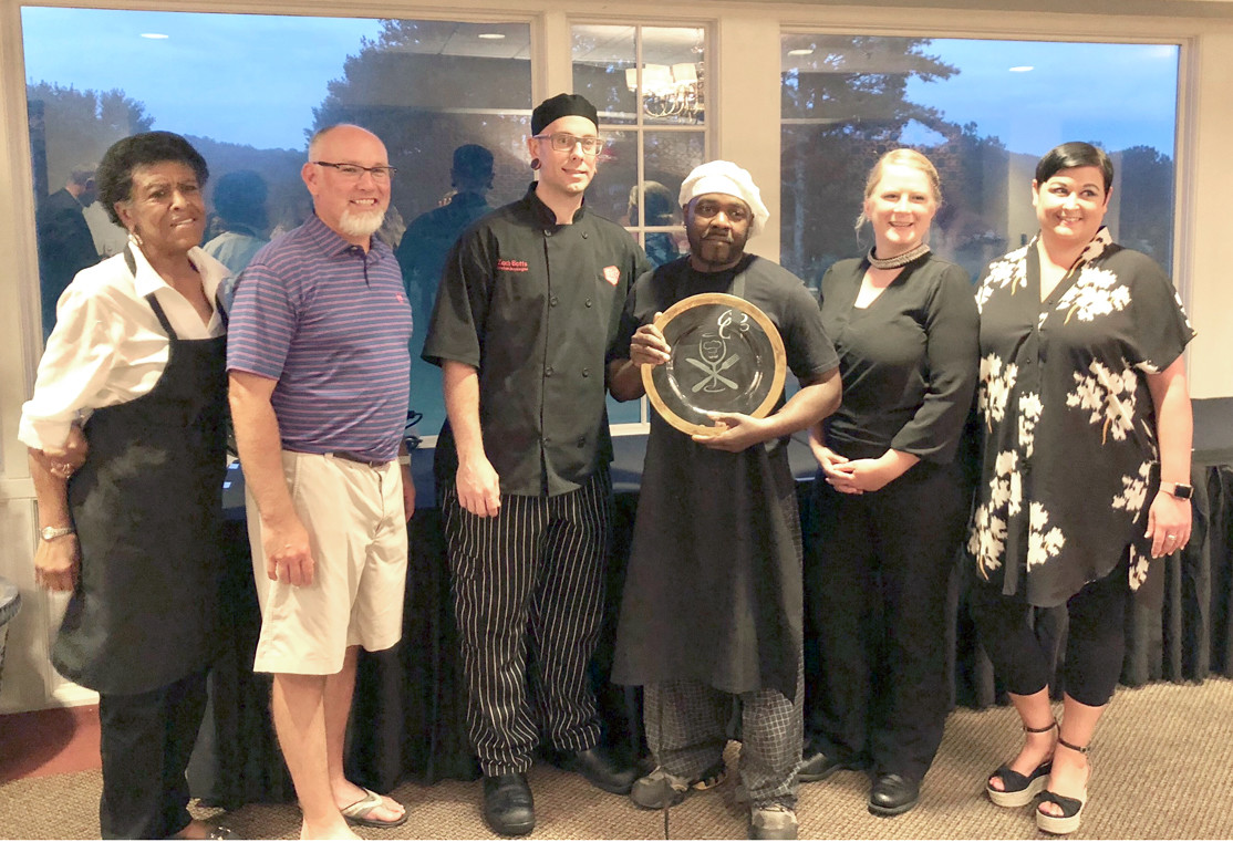 Hospice of Chattanooga recently held its sixth annual Chef Showdown fundraiser with the chef of the Cleveland Country Club gaining bragging rights for 2018. From left are chef participants Regina Piersal, local caterer; Scott McGowan, Old Fort Restaurant; Zach Botts, Stack; 2018 Chef Showdown Winner - Tra Harris, Cleveland Country Club; Ashlee Anderson, Fulin's; and Lauren Julian, Aubrey's.