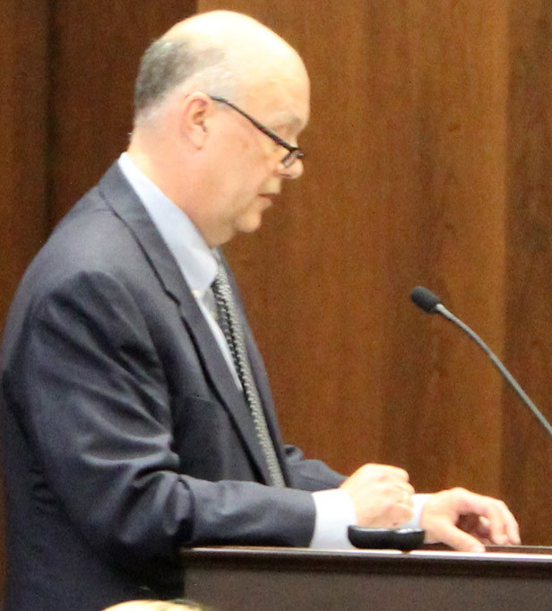 "TENNOVA-CLEVELAND President and CEO Coleman Foss, right, speaks before the Tennessee Health Services and Development Agency board Wednesday in Nashville. Foss told board members that facilities at Tennova's current campus are landlocked, making expansion impossible. At left, Erlanger lead executive Joe Winick encouraged the THSDA board to deny Tennova's certificate of need request, stating that inefficiencies at Tennova's current hospital emergency room were ""self-inflicted."""