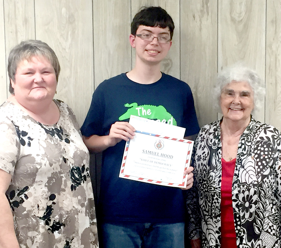 """The Voice of Democracy""  2018 Essay winner for Bradley County is Sam Hood, a student at Walker Valley High School. This year's essay theme was ""American History: Our Hope for the Future.""   The annual essay contest is sponsored by the VFW, VFW Auxiliary Post 2598 and Bradley County 4-H.  Presenting a certificate and $25 check, are Kathryn Ervin, Bradley Co. 4-H representative, Hood, and Wilma Goins, past department president of Auxiliary Post 2589."