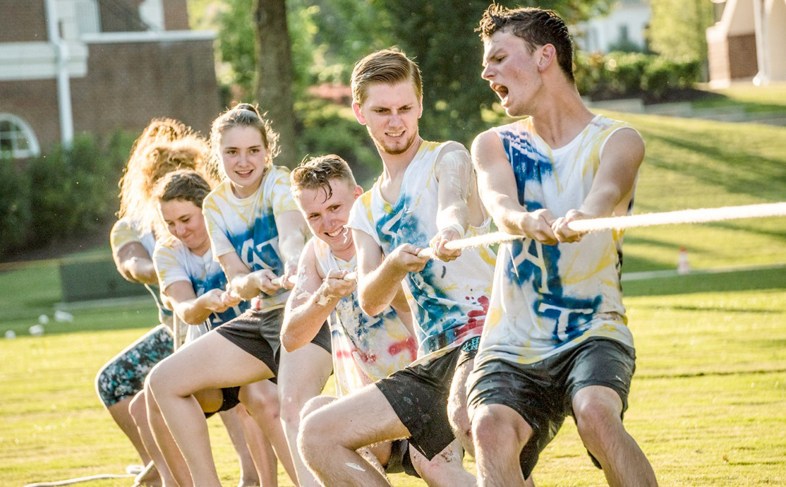 Summer Honors students are shown at the traditional Greek Olympics, competing in tug of war.
