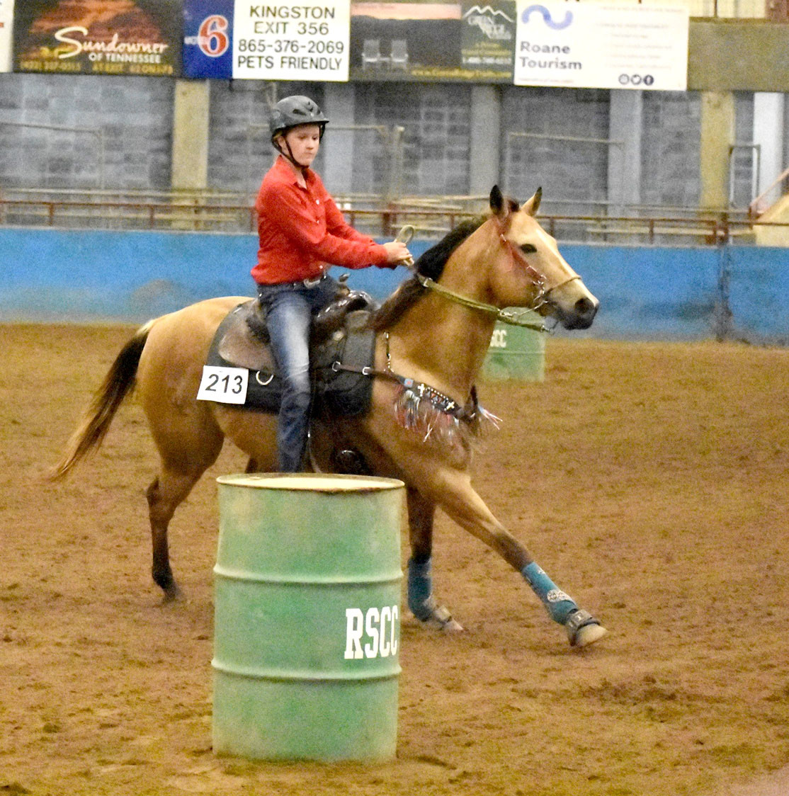 Payton Schwager rides as quick as she can past the barrels in her Barrel Racing division.
