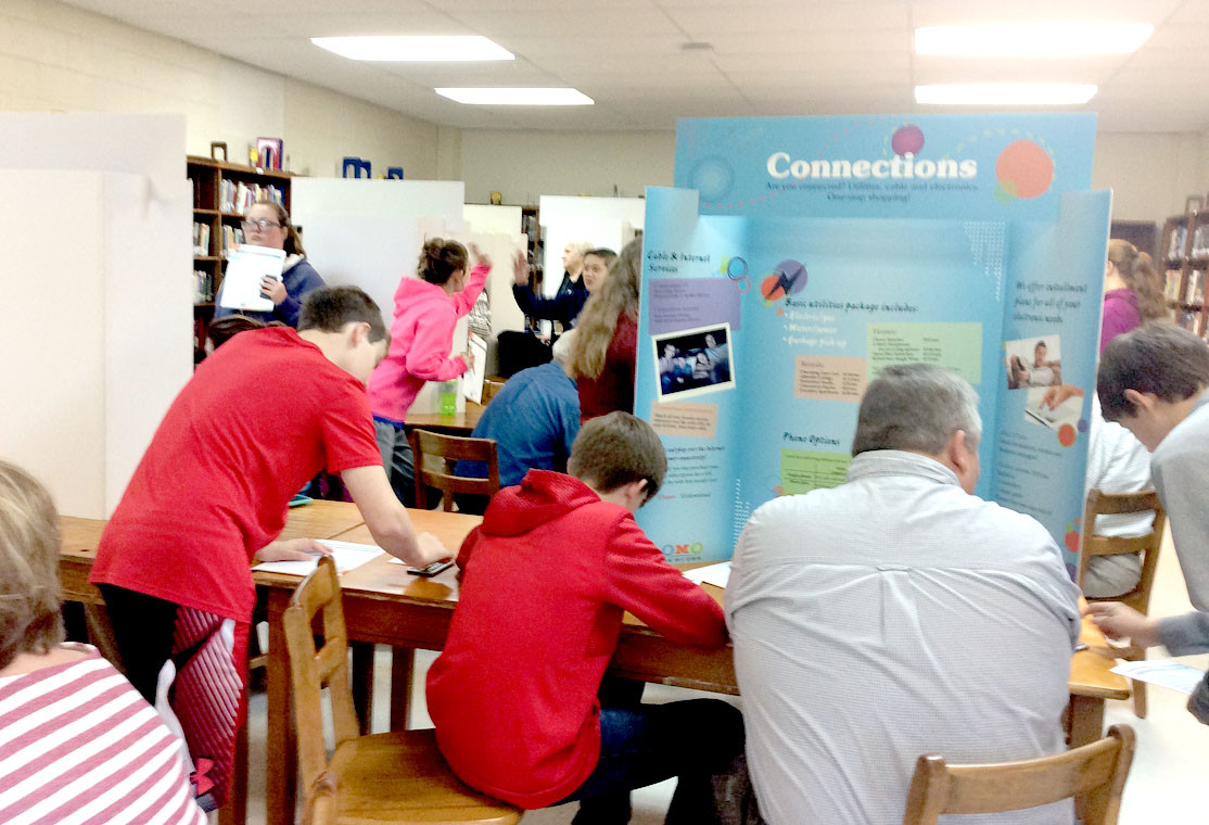 At the Connections station, Greg Paxton assists students with choosing from a wide variety of options for utility and internet services.