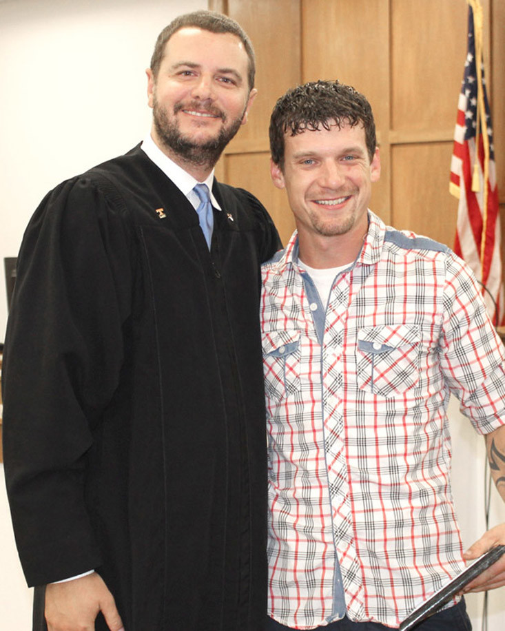 TENTH JUDICIAL District Circuit Court Judge Andrew Freiberg congratulates Mental Health Court graduate Roy Jackson III during a ceremony Tuesday afternoon at the Bradley County Judicial Complex.