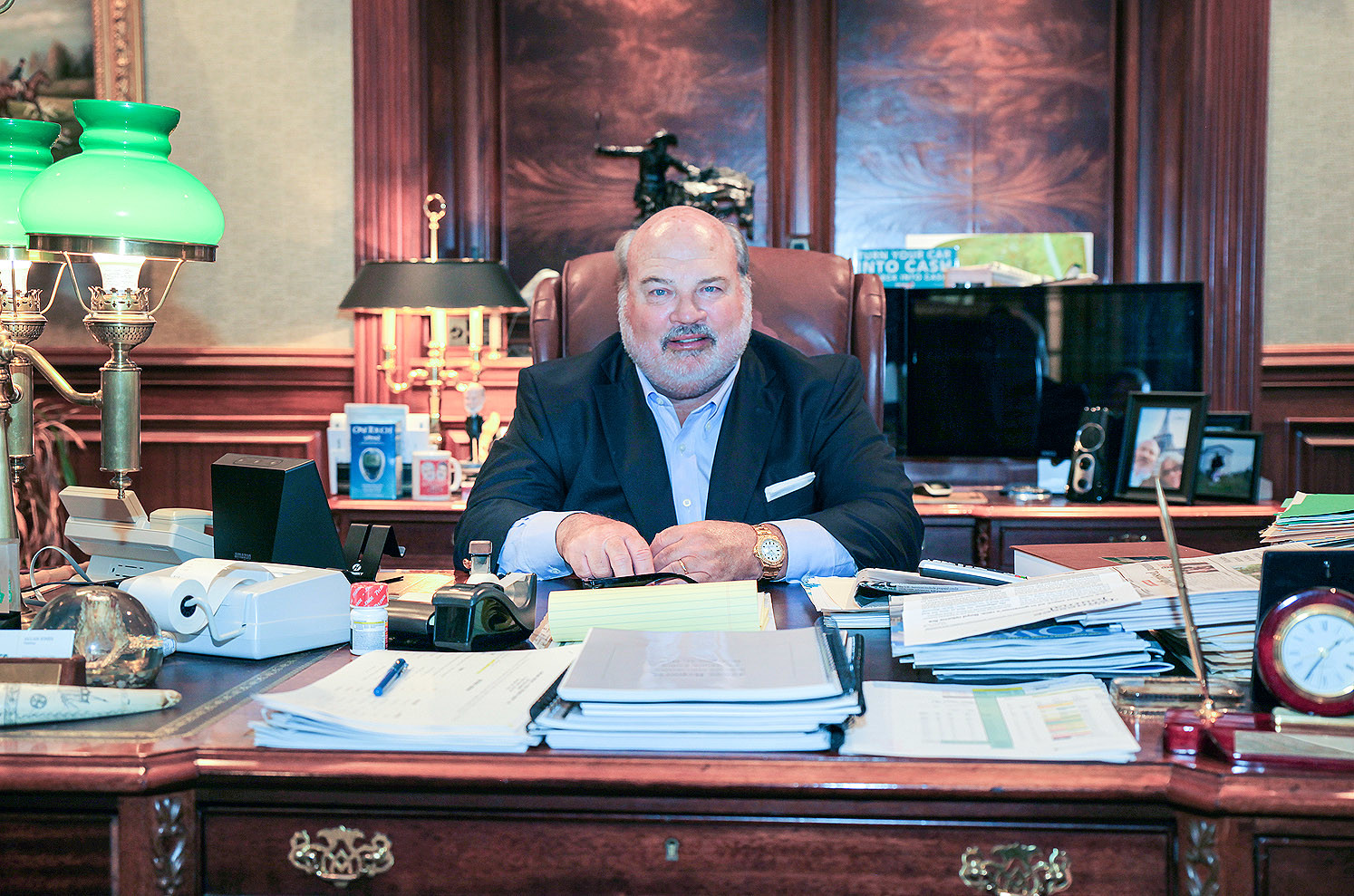 ALLAN JONES, a civic leader and philanthropist, as well as a high-profile Cleveland businessman speaks on the 25-year history of Check Into Cash from his very busy desk.
