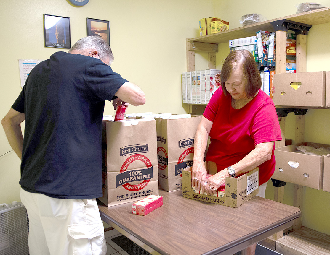 SORTING food into bags, volunteers serve the families local nonprofit The Caring Place continues to see during the summer months. They are gearing up for a summer food drive.