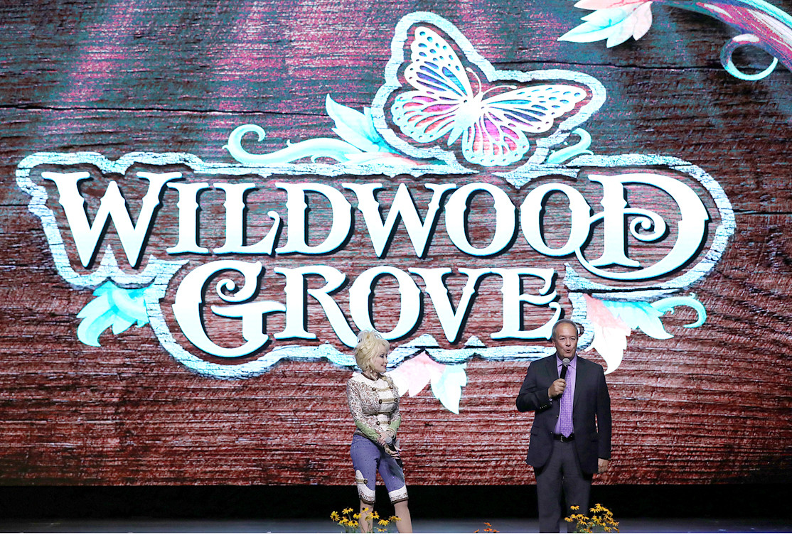 DOLLYWOOD COMPANY PRESIDENT Craig Ross stands alongside Dolly Parton as the two explain the variety of new features to be added to the upcoming park expansion, Wildwood Grove. Some features include a new roller coaster, family section and even a new restaurant, all centered around a massive Wildwood tree, which will serve as a natural stage for musical performances throughout the day. 