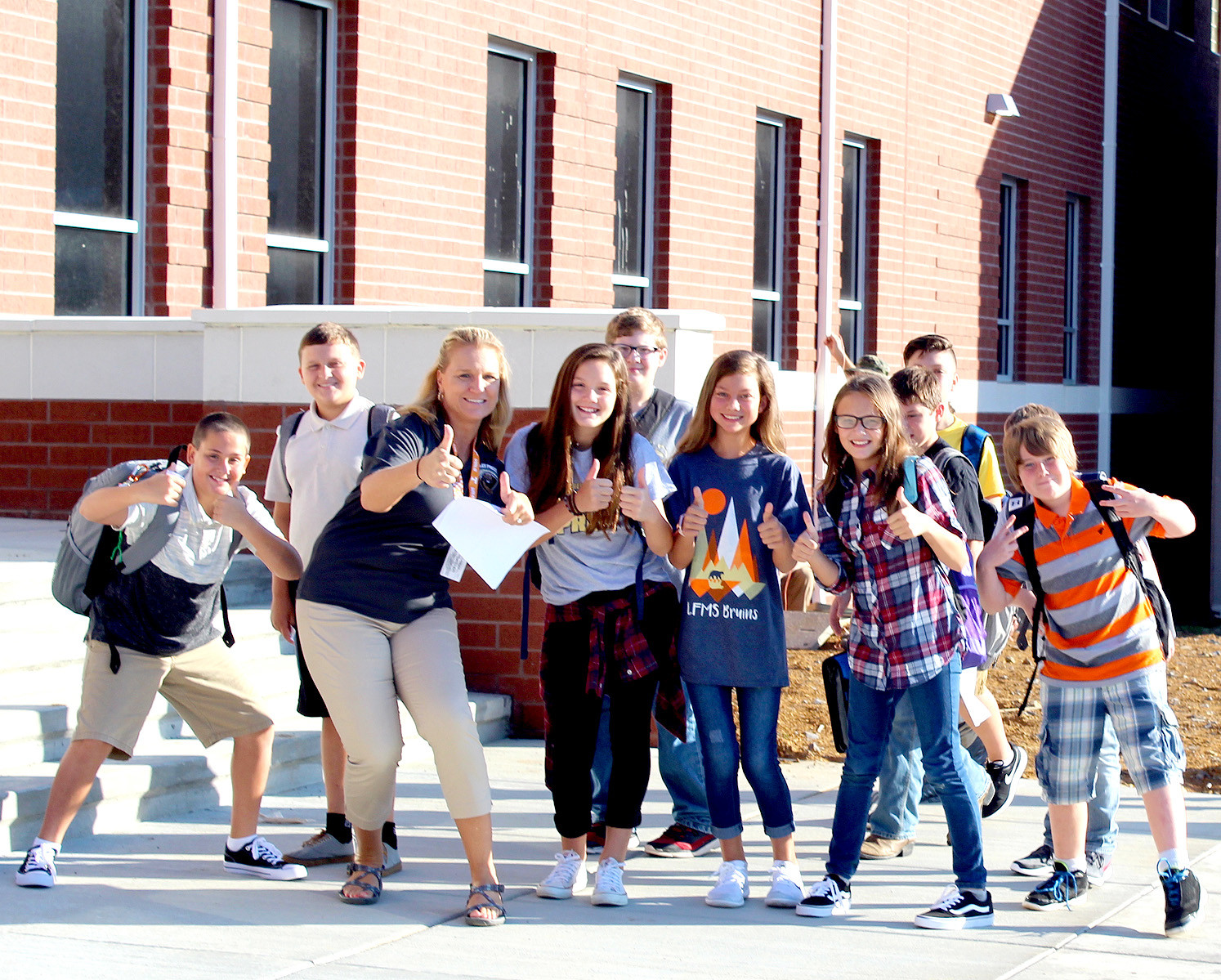 STUDENTS in Angie Underwood's sixth-grade homeroom class pause for a quick photo before heading to class for the first time. Lake Forest Middle School welcomed students to its new academic building Tuesday.