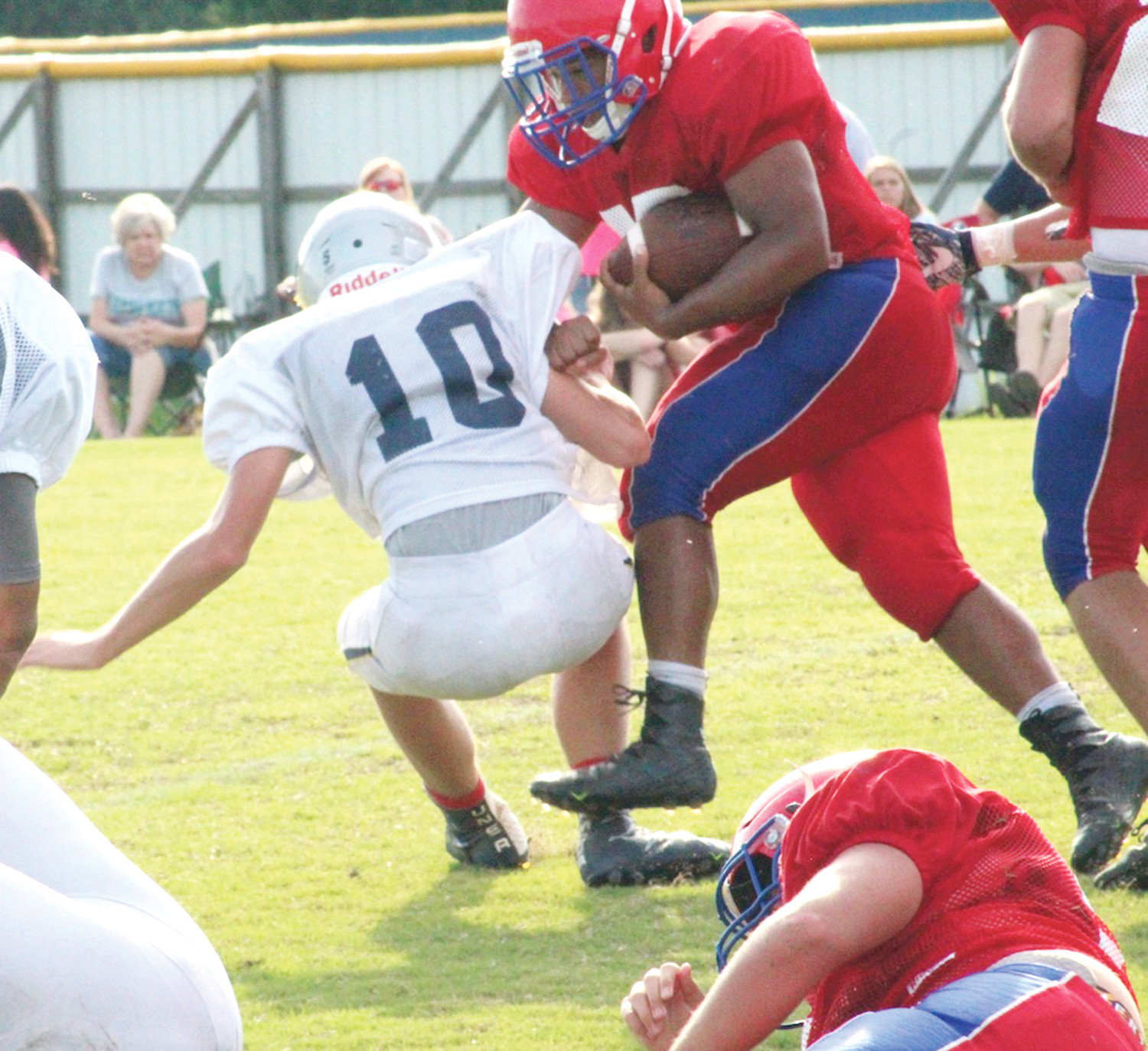 POLK COUNTY fullback Eddie Lamb plows through a Walker Valley defender during a scrimmage Tuesday evening.