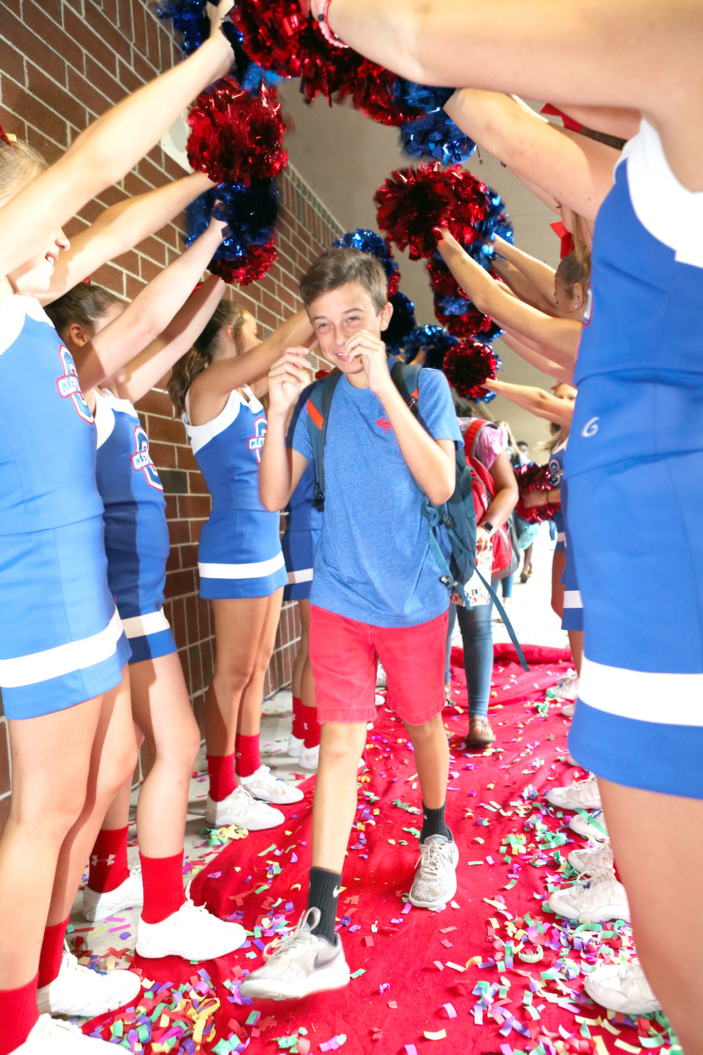 SOME OF CLEVELAND MIDDLE School's cheerleaders greet returning student Trent Walker with a cheer as he walks down the red carpet for the first day of the 2018-19 school year.