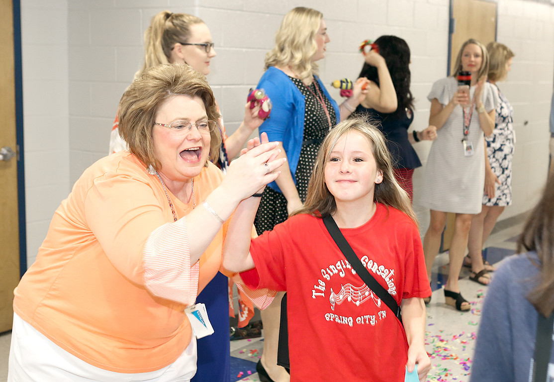 DR. LENEDA LAING, left, enthusiastically high-fives CMS student Maddie Bell early Tuesday morning.