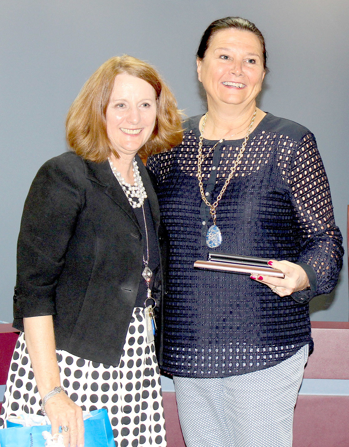 FOURTH DISTRICT Bradley County Board of Education member Dianna Calfee, right, is thanked by Director of Schools Dr. Linda Cash during Thursday's board meeting. It was her final meeting following her loss in the Aug. 1 election.