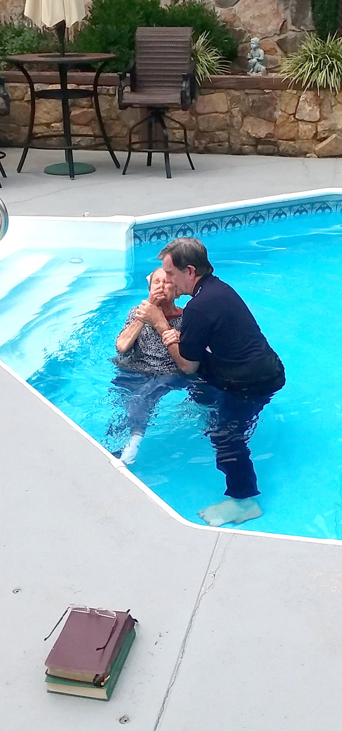 DOT CRAIGO was baptized in a pool by her pastor, the Rev. Dr. Phil Sumrall.