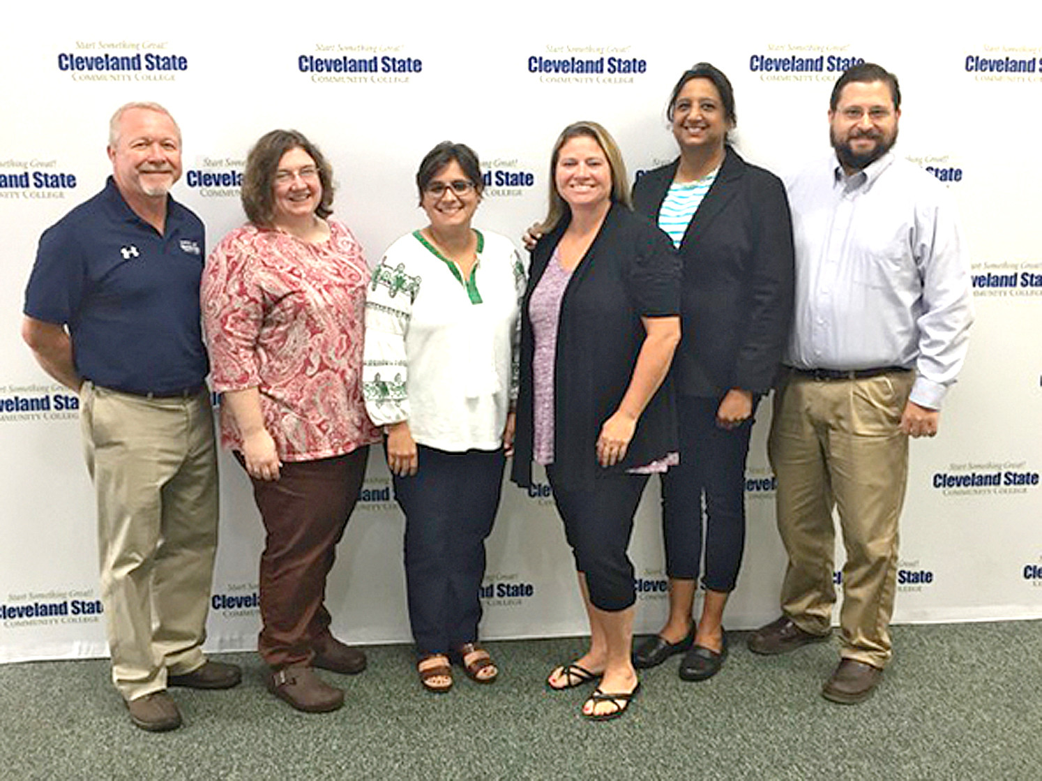 Several CSCC employees received awards for their recent promotions. From left are Darrell Oakley, assistant professor; Jenny Eble, associate professor; Rebecca Riggs, associate professor; Candace Patterson, associate professor; Maureen Baksh-Griffin, associate professor; and Stephen Hays, professor. Dr. Tim Wilson, associate professor, was not available for the photo.