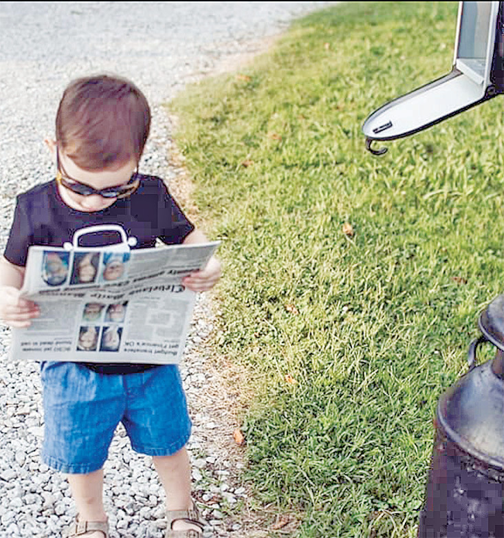 Maxine Jones shared this photo of her great-nephew, Memphis Osborne, son of Eric and Mercedes Osborne–Memphis, checking to see if his name was in the paper. He just turned 2 Aug. 25.