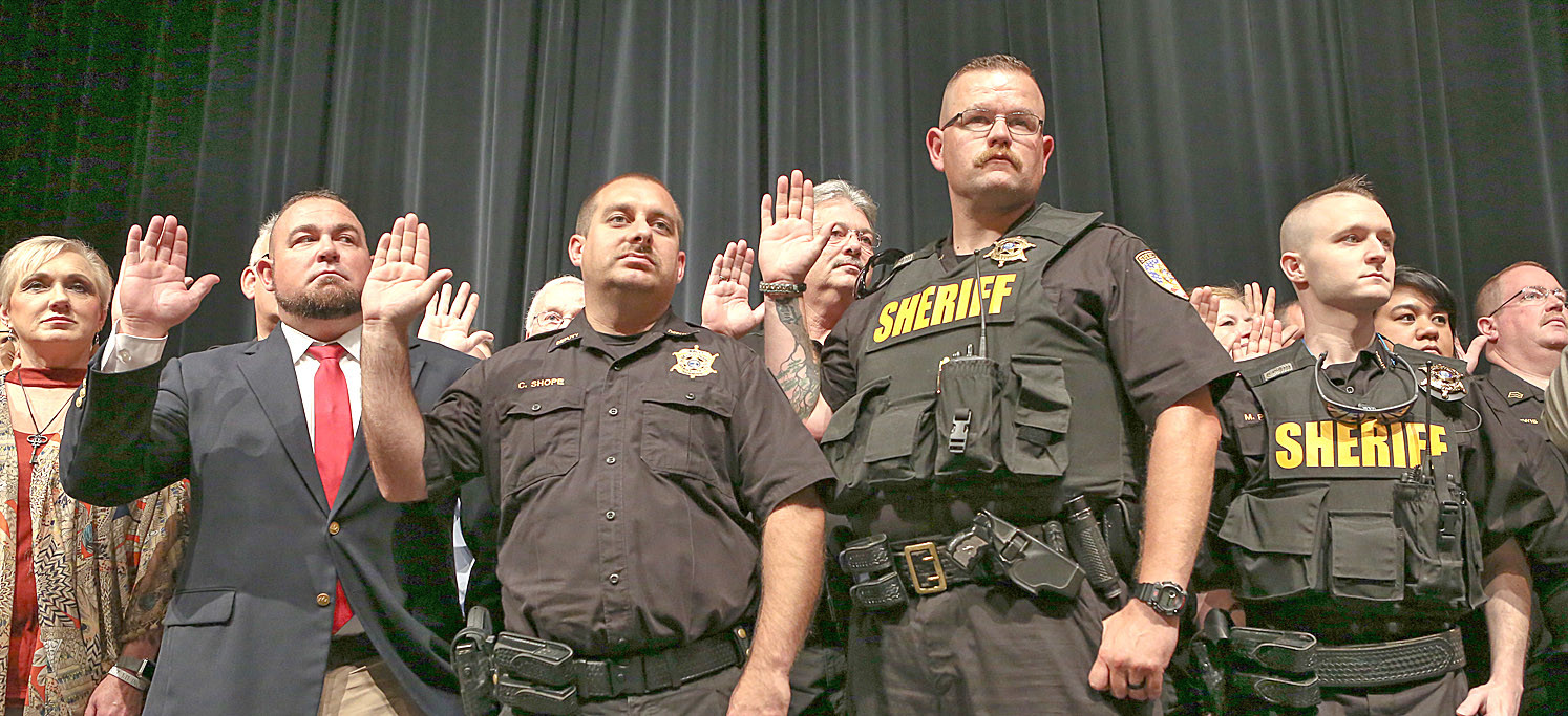 BRADLEY COUNTY SHERIFF'S DEPARTMENT staff and officers in attendance take the Oath of Deputy Sheriff as administered by Judge Larry Puckett at Saturday's BCSO Swearing-In Ceremony.