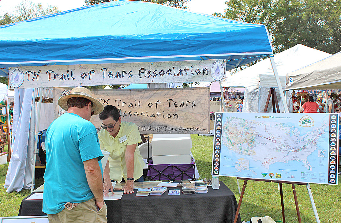 HISTORIAN DEBBIE MOORE was busy at Saturday's International Cowpea Festival and Cook-off giving out information. She was busy with one of the festival-goers above discussing the Trail of Tears, the Cherokee Nation, and the history of the City of Charleston.