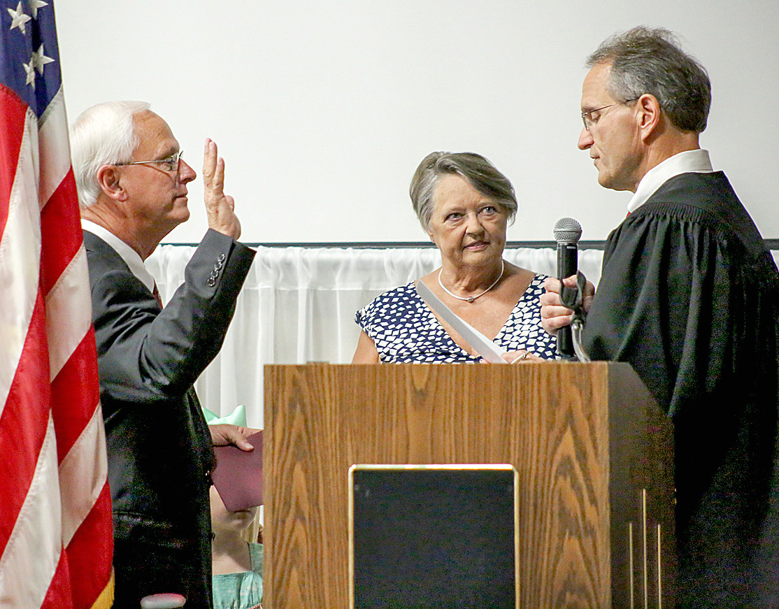 NEWLY ELECTED COUNCILMAN At-Large, Ken Webb, joined by his wife, Dianne, takes the Oath of Office administered by Circuit Court Judge J. Michael Sharp at Monday afternoon's event at the Museum Center.